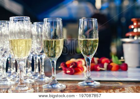 Glasses Of Champagne On Table Served For Buffet Catering Party Outdoors. Cocktail In Wedding, Fair,