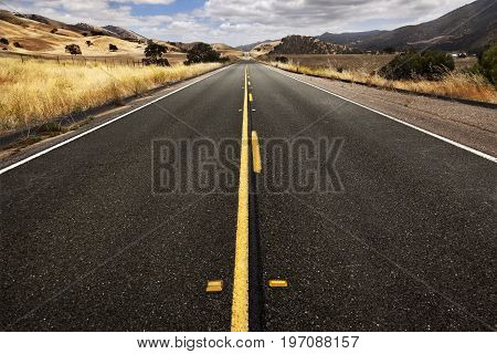 One road on California to horizon. USA