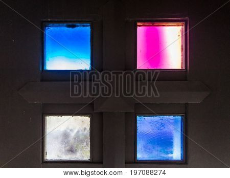 Four Small Colorful Stained Glass Window Squares Closeup