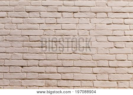 Painted white brick wall background. Old brick wall texture.