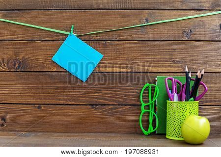Book glasses and school supplies. Card. The concept is back to school.