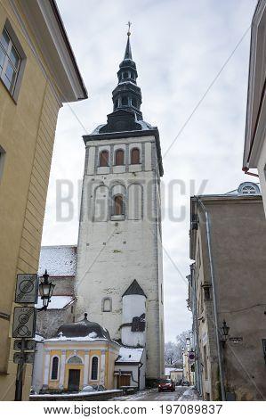 TALLINN ESTONIA - FEBRUARY 23 2016: Saint Nicholas church in Old Town of Tallinn Estonia. Old Town is listed in the UNESCO World Heritage List
