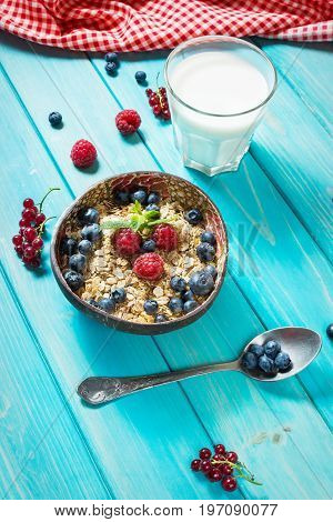 Multigrain wholewheat healthy cereals with fresh berry and a glass of juice for breakfast