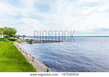 Champlain, Canada - May 29, 2017: Small Red And White Lighthouse And Pier In Town On Chemin Du Roy W