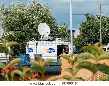STRASBOURG FRANCE - JUN 30 2017: Viastoria Media Television Trucks with multiple Satellite parabolic antennas and fiber optic cables preparing to report live the official European Ceremony of Honour for Dr. Helmut Kohl at European Parliament
