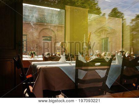 Restaurant table setting view through window in German city of Rastatt