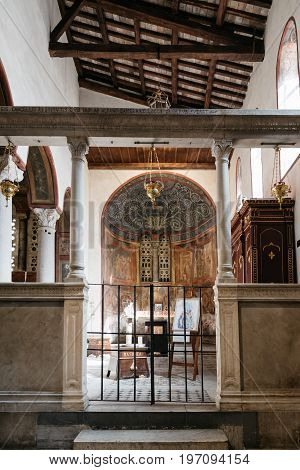 Rome Italy - August 18 2016: Interior view of church of Santa Maria in Cosmedin. The Mouth of Truth is a marble mask in Rome Italy which stands against the left wall of the portico of the Santa Maria in the Cosmedin church