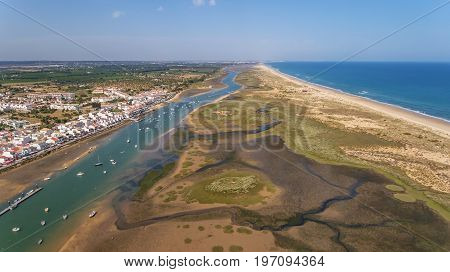 Aerial. Ria Formsa Tavira is filmed from the sky in the summer. Cabanas