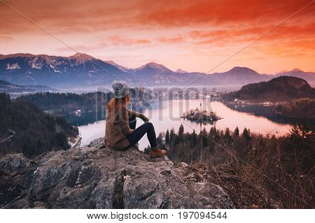 Traveling Young Woman Looking On Sunset On Bled Lake, Slovenia, Europe
