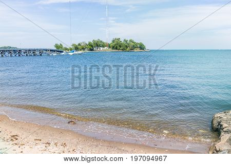 Bronx, Usa - June 11, 2017: City Island Harbor With Boat On Pier And Sandy Beach With Ocean