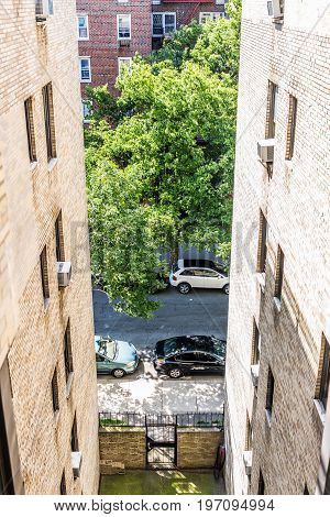 Bronx USA - June 11 2017: Aerial view of residential apartment building and street road with sidewalk in downtown Fordham area