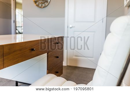 Closeup Of Modern White Chair And Desk In Office In Room Of House