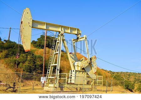 Pumpjack industrial mechanical equipment which is used to uplift oil and natural gas from an Oil Well taken in a rural field