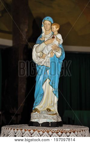 Niteroi, Brazil - January 26, 2013. Close-up of statuette with image of Our Lady holding the boy Jesus in the Santuário das Almas church, in the coastal city of Niteroi. Located in the Rio de Janeiro State, southwestern Brazil