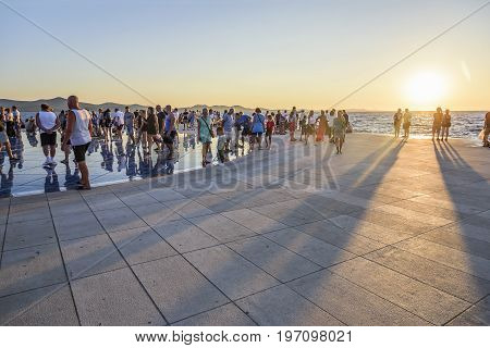 ZADAR, CROATIA - JULY 14, 2017: Greeting to the Sun after sunset. 300 multi-layered glass plates, inside of which are solar panels, accumulating energy during the day.