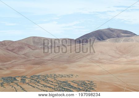 Desert mountains and electrical station on top of it