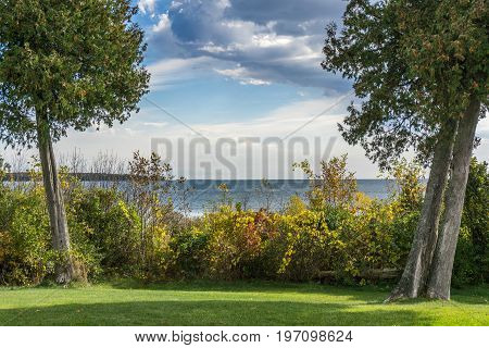 Cedars frame a dramatic vista overlooking Lake Michigan in Door County Wisconsin