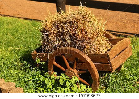 Decorative Horse Cart With Hay As A Landscape Design