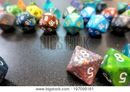 collection of various polyhedral dice on table