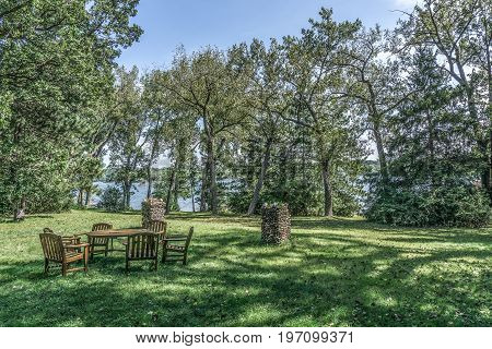 Teak Lawn Furniture and funky river rock planters over-looking Lake
