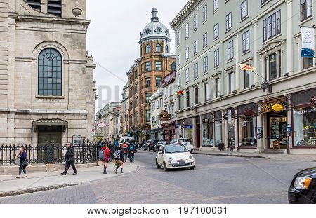 Quebec City, Canada - May 29, 2017: Old Town Street With Shops And Stores With Stone Wall Brick Buil