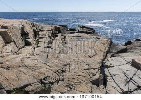 Jagged Rocks On Shoreline In Acadia National Park