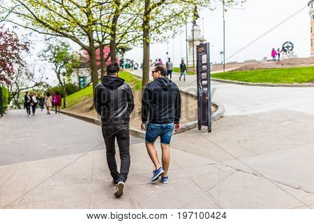 Quebec City, Canada - May 29, 2017: Old Town Street With Two Men People Walking Downhill By Hotel Ch