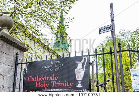 Quebec City, Canada - May 29, 2017: Old Town Street With Cathedral Holy Trinity Sign Advertisement A