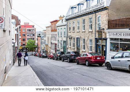 Quebec City, Canada - May 29, 2017: Old Town Steep Street On Incline With People Walking Down By Res