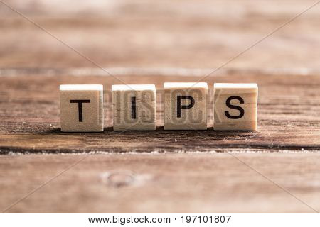 Tips word collected of wooden elements with the letters
