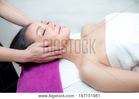 Beautiful Woman Is Getting A Facial Massage In The Spa Salon