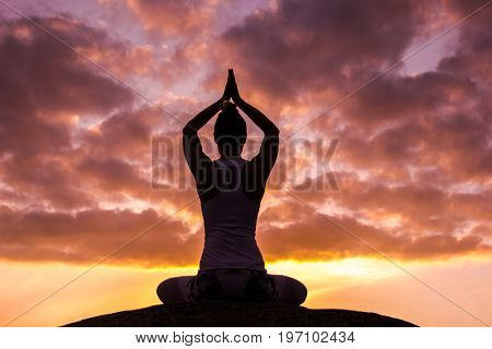 caucasian fitness woman practicing yoga at s