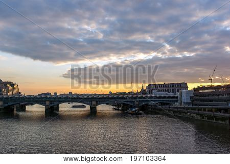 LONDON, ENGLAND - JUNE 18, 2016: sunset Cityscape from Millennium Bridge and Thames River, London, Great Britain