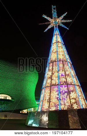 Christmas tree and illuminated Bullring Shopping centre in Birmingam at night