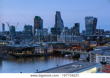 LONDON, ENGLAND - JUNE 18, 2016: Sunset panorama from Tate modern Gallery to city of London, England, Great Britain