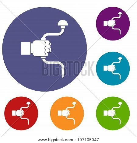 Vintage hand drill in man hand icons set in flat circle red, blue and green color for web