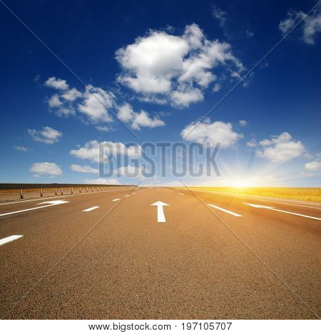 Asphalt car road and clouds on blue sky in summer day