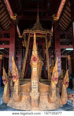 Front side picture of the naga on the ceremonial barge in the funeral hall of Wat Xieng Thong.