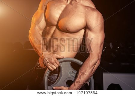 man in gym. Muscular bodybuilder guy doing exercises with barbell. Strong person with Tense male hand with veins barbell. Modern journal toning. Flare for text and design