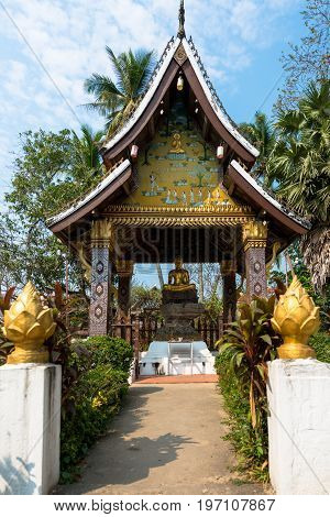 Small temple in a sunny day at Wat Xieng Thong located in the city Luang Prabang Laos.