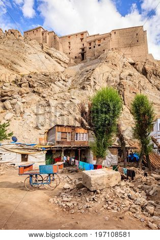 Residential courtyard in Leh, India with Leh Palace in the backdrop