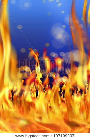 Close up fire flames over blue background