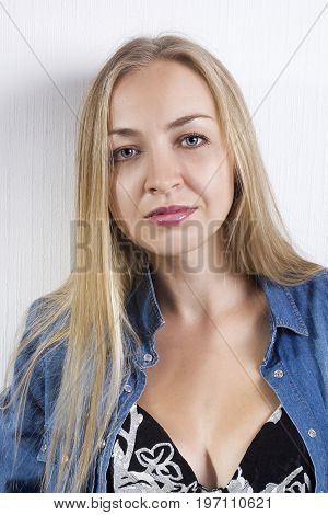 Portrait of a young beautiful blonde woman with blue eyes