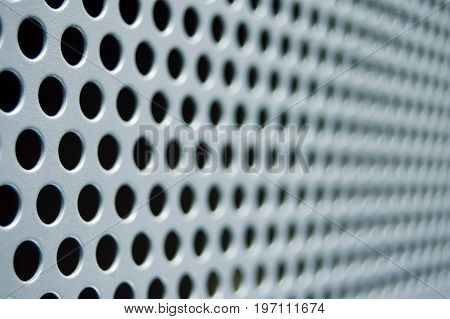 A grid pattern of holes found in a stablizing panel.