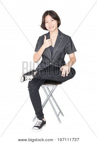 Young Women Sit On Chair Over White