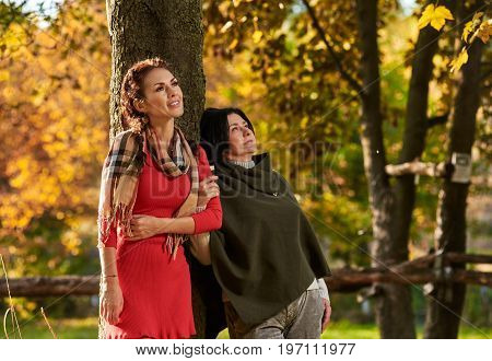 Portrait of attractive senior mother with daughter relaxing outdoors