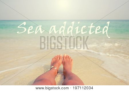 Woman's Bare Feet on the beach. Sand texture. Sea addicted.