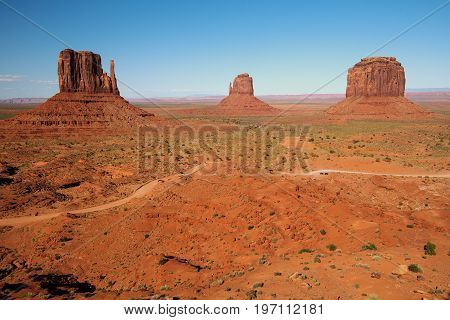 The two Mittens and Merrick Butte in Monument Valley Navajo Tribal Park as seen from the Visitors Center