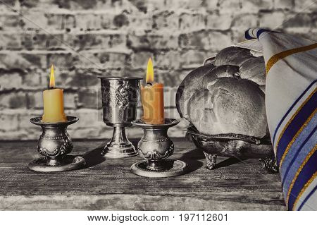 Silver Kiddush Cup, Crystal Candlesticks With Lit Candles, And Challah