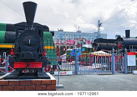 Novosibirsk Museum of railway equipment in Novosibirsk Siberia Russia - July 3 2017: the tank - engine of the German firm Borsig ( 19th century ) at the main entrance